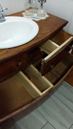 The middle drawer is notched around the p-trap. The top drawers width was cut in half to function around the sink bowl.
