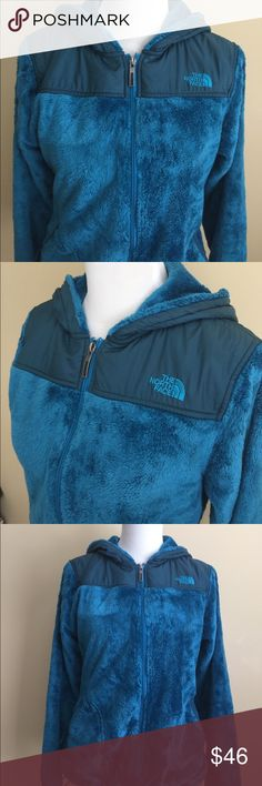The North Face Blue Hooded Zip Up Jacket Warm and Cozy North Face Zipper Jacket. Hood is lined, jacket is unlined. Sold as is. Noticeable wear and pilling to zipper pockets. Bungee Adjusters are stretched but still function. Feel free to contact with questions. ⭐️Open to Offers! ⭐️ The North Face Jackets & Coats