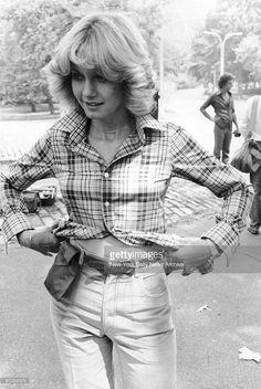 Olivia Newton-John models fashion for August issue of Harper's Bazaar in Central Park.