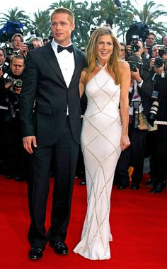 Style, Style: Red Carpet, ...   In 2004, Jennifer Aniston dazzled in an embellished Atelier Versace gown halter dress when she accompanied then-husband Brad Pitt to the premiere of Troy .