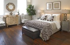The layered textured bedding gives this bedroom a Farmhouse Glam type of look.      Find out what type of home decor style you have by taking our Stylescope quiz. Click here!
