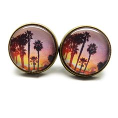Sunset Palm Tree Earrings Handmade earrings with sunset palm tree images under glass domes. Bundle 3 pairs for $12, comment with your choices or create a bundle to get discount. ❤️. Customer photos shown for size comparison only. Handmade Jewelry Earrings