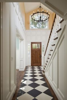 A painted runner in black and white checks adds interest to this entryway.