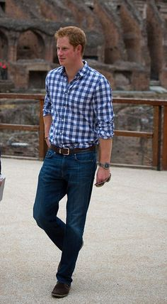 Prince Harry dressed down in jeans and a shirt after wearing military uniform and then a suit and tie earlier in the day, as he visits the Colosseum on 19.05.2014 in Rome, Italy