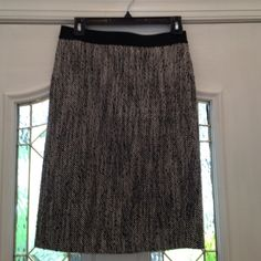 Tweed pencil skirt w/ elastic waistband Black and white tweed pencil skirt. Very sexy secretary! Pair with pumps or flats and a little black sweater. Dalia Collection Skirts Pencil