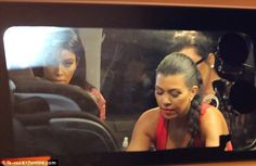 So serious: Kim and Kourtney looked ready for bed as they piled into a car with Kris...