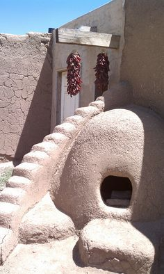 An earthen oven and dried chiles at Taos Pueblo.