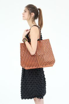 Rachel Comey Punched Tote found at http://www.beklina.com