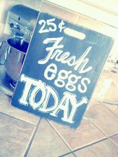 Fresh Farm Eggs sign - made this by spray painting (chalkboard paint) a 99cent cutting board from the thrift store and writing in chalk the lettering.