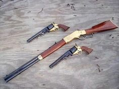 Three beautiful weapons: one Winchester rifle and Two Colt Navy revolveres.