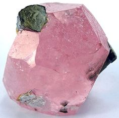 Pink morganite crystal with dark tourmaline from Afghanistan.