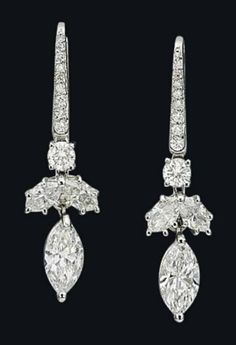 A PAIR OF DIAMOND EARRINGS, BY GRAFF Each set with a marquise-shaped diamond surmounted by two marquise-shaped and a brilliant-cut diamond, to the graduated diamond line surmount, mounted in platinum and gold, 3.3 cm, in navy blue leather Graff pouch Signed Graff, no. 7337
