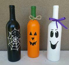 Halloween Wine Bottle Trio Selvmade, N., Selvmade Halloween Wine Bottle Trio Source by . Fall Wine Bottles, Halloween Wine Bottles, Christmas Wine Bottles, Wine Bottle Art, Painted Wine Bottles, Diy Bottle, Bottle Garden, Vodka Bottle, Decorative Wine Bottles