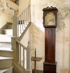 In an 1830 Greek Revival, the stair hall is painted with a mural in the manner of early American itinerant painters. (Photo: Gridley + Graves)