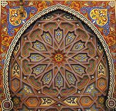 Pure Moroccan art. Hand painted and sculpted wooden door. Rabat, Morocco.