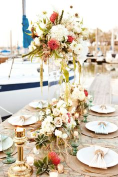 Incredible wedding centerpiece idea; photo: Azure B Photography and Cherie Hogan Photography via The Perfect Palette