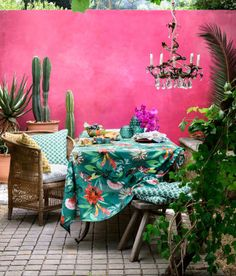 A colourful Morrocan style patio but it could equally work in a garden room Shocking Pink walls tropical print table cloth chandelier and indoor plants # Decor, Garden Room, Interior And Exterior, Interior, Indie Room, Home, Table Cloth, House Styles, Pink Walls