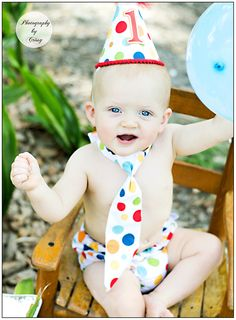 1 year birthday session in park with polka dot hat/tie/diaper cover