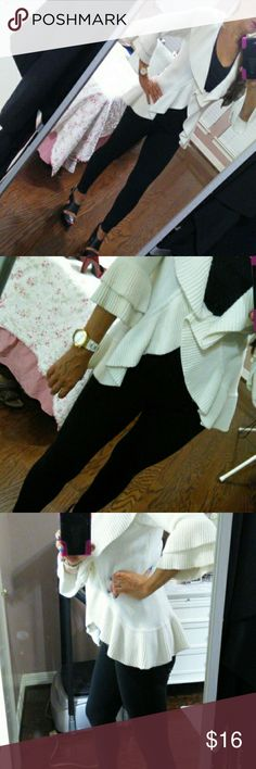 Three-quarter sleeve off white sweater Cute ruffled three-quarter sleeve off white sweater very cute. Ruffle all the way around the collar sleeves and bottom.  One button in the front to close.  This is great to wear over anything dress up or dress down yvos Sweaters Cardigans