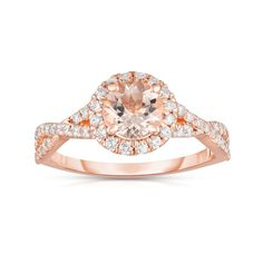 Declare your everlasting love with this truly stunning engagement ring from our collection, featuring a shimmering round-cut morganite center stone with the perfect accent of 0.45 ct shimmering round white diamond side stones. Crafted of lustrous 14-karat rose gold with a high-polish finish, this gorgeous engagement ring is guaranteed to impress. The total carat weight may range from 0.38-0.42 carats. Smoky Topaz, Unique Diamond Rings, Bohemian Rings, Everlasting Love, Morganite Ring, Rose Gold Engagement Ring, Dream Ring, Stone Rings, Cocktail Rings