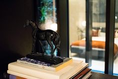Bronze horse sculpture luxury home accessories on display in the study - Kenure House project by Echlin London design studio. Luxury home located close to Holland Park, London including many  contemporary and British designs. Featuring on the Martyn White Designs Blog www.martynwhitedesigns.com