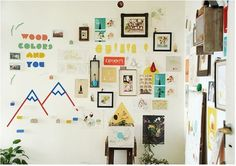 Your wall doesn't solely have to be home to photographs. Mix it up for some dynamism!