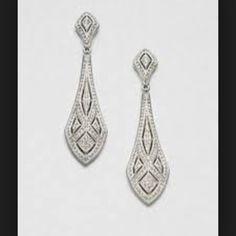 Diamond cut earrings. Long elongated.