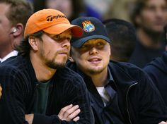 He whispers sweet nothings into Mark Wahlberg's ear. | 26 Things That Happen When Leonardo DiCaprio Goes To A Basketball Game