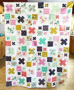 "Fun colors in this ""Mustang Kiss"" quilt top by Sarah Stasiuk of Sew and Tell Handmade."