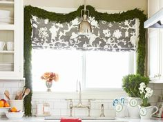 Drape garland around your kitchen window. From the HGTV Magazine December issue! #hgtvholidays http://www.hgtv.com/decorating-basics/quick-holiday-decorating/pictures/page-17.html?soc=hpp