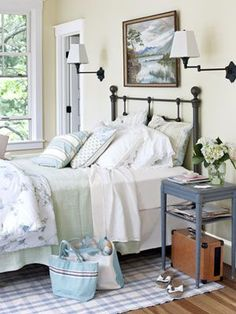 Vermont Master Bedroom In this master bedroom, an antiques store oil painting of the Vermont landscape hangs above an iron bed by Hilsdale Furniture.    Read more: Bedroom Design Ideas - Guide to Bedroom Design - Country Living