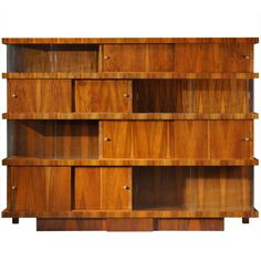 This modernist bookcase would pair well with my bar!   From the 30's.  Love the glass front areas and balance of the concealed areas.  Beautiful harmony.