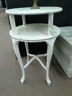 $65 - This petite two-tier table has been painted a creamy white and distressed. Nice detailing is accented by the paint and distressing. The table measures 18 inches in diameter and stands 27 inches tall. It can be seen in Booth B15 at Main Street Antique Mall 7260 East Main St ( E of Power Rd ) Mesa 85207  480 9241122open 7 days 10 till 530 Cash or charge