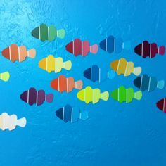 Option for theme environment/decor - Find a fish punch (or trace an outline) onto paint samples. You have an instant fish wall for your beach theme classroom! Under The Sea Theme, Under The Sea Party, Under The Sea Crafts, The Ocean, Ocean Crafts, Paint Cards, Paint Samples, Classroom Themes, Ocean Themed Classroom