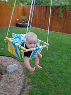DIY Baby Hammock Swing by onesassyhousewife: Terrific! Made for under thirty dollars!