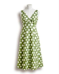 Cute 50's style dress with polka dots. I love this dress. If it were orange I would love it more.
