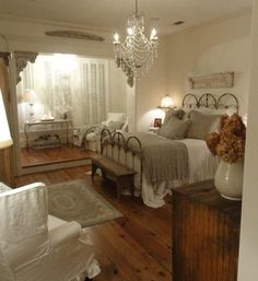 I love gray, white bedrooms... and absolutely love chandeliers in the bedroom! These floors are great too!