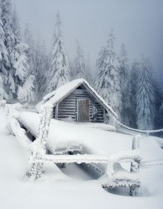 Deserted cottage in the mountains after heavy snowfall. Carpathian Mountains, Ukraine. Europe .