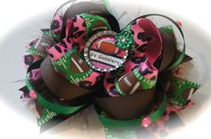 Love the color combinations pink & green football hair bow