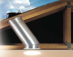 The solar tube, or sun tube, looks like a recessed lighting fixture from the interior of a space. A tube reaches the ceiling by snaking through the roof structure. It is connected to a light capturing element positioned on the exterior of the roof. Solar tubes are a good alternative when it is not possible to install a skylight due to the location of an attic space or interference from your roof's structural elements or ductwork.
