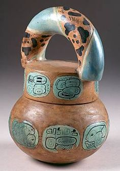 American Heritage Chocolate - This beautiful vessel is a screw top lid jar for cacao from Tomb 19 in Rio Azul, Guatemala and dates from 400-535 AD.
