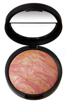 Laura Geller Blush n Brighten in Golden Apricot. Lovely blush, great color payoff, and can double as a highlight on the tops of cheeks