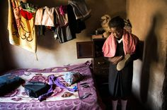 Madalitso Mulando brushes off her shoes before heading to school in Lusaka, Zambia. Last year, she missed a whole semester while her parents struggled to scrape together tuition.  - teaching global perspective
