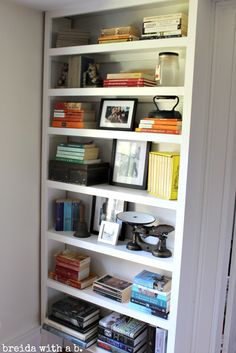 Bookshelves Arranged by Color - love how this is staged / via Breida with a B