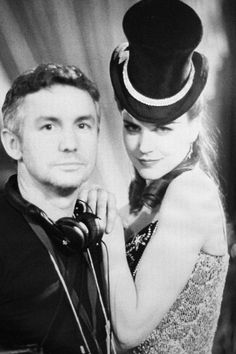 Nicole Kidman with director Baz Luhrmann on the set of Moulin Rouge!, 2001.