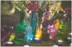 Colorful bottles as wedding centrepieces