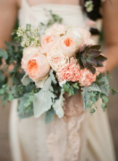 Who says carnations are old fashioned?! Peach carnations are a nice addition to this Juliet garden rose + succulent bouquet.