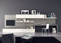 #Living-room includes desk. Designed by #Scavolini