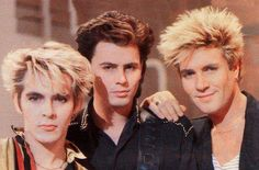Duran Duran. Nick- intense. LeBon- great smile. JT- distracted by a model in the audience, perhaps? Anyway- great picture.