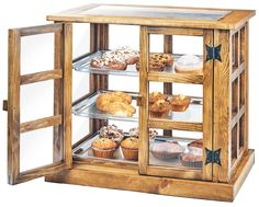 Item: 3621-99   Madera Paneled Bakery Case Help make your presentations stand apart, with the Madera Paneled Bakery Case. The clear top and paneled 4 sides allow in the perfect amount of light to showcase your baked goods. Combined with the unique door hinges, this is a truly unique product!